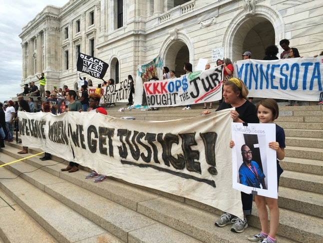 Protesters gather outside the state capitol in St. Paul, Minnesota.