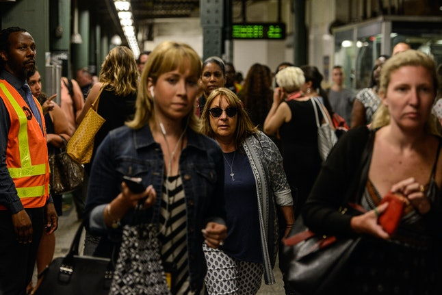 Commuters transfer from Long Island railroad service to a New York City subway at the Barclays Center station on July 10 in New York City.