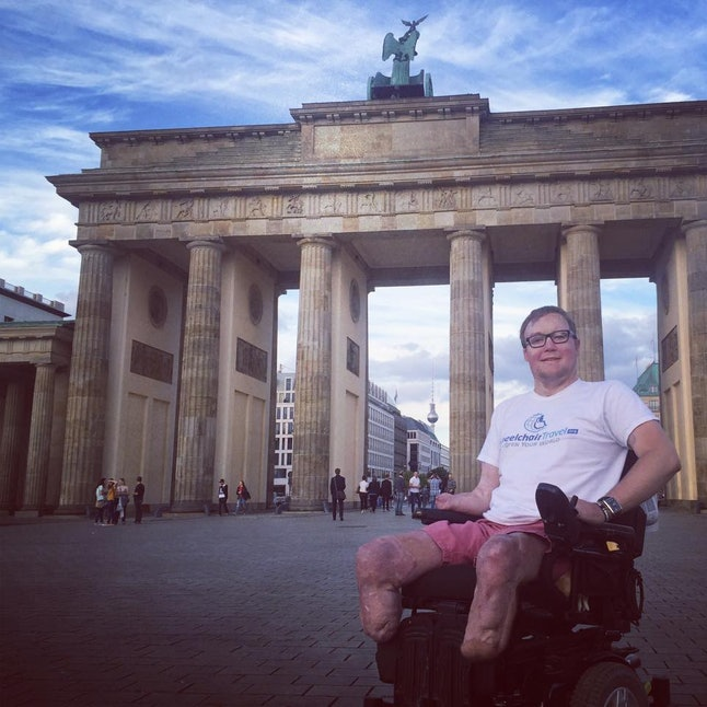 John Morris in front of Brandenburg Gate in Berlin