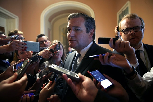 \U.S. Sen. Ted Cruz (R-TX) is surrounded by members of the media after he viewed the details of a new health care bill.