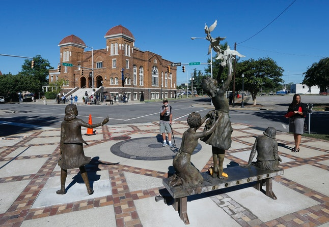 Birmingham's Sixteenth Street Baptist church and the statue honoring the four young black girls killed in a bombing there