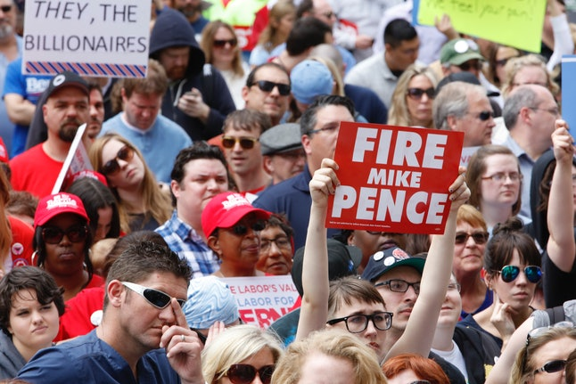 """This """"Fire Mike Pence"""" sign, seen at a Bernie Sanders rally in April pretty much says it all."""