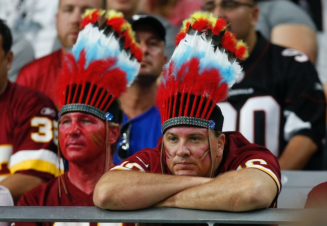 Two fans attending Sunday's Washington Redskins game.