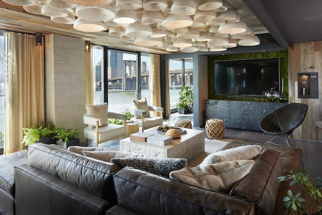 A living room in the 1 Hotel Brooklyn Bridge