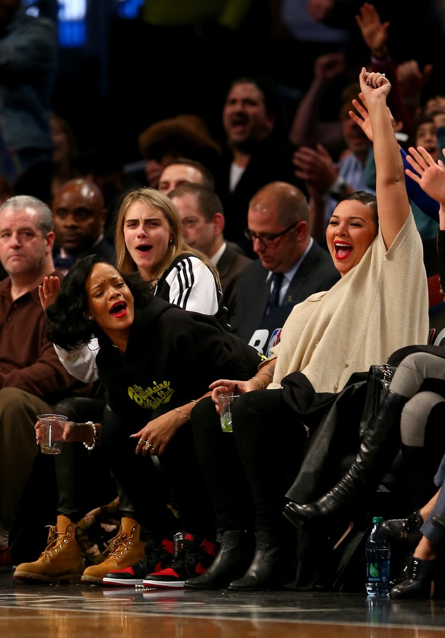 Rihanna (middle) at a game between the Brooklyn Nets and the Atlanta Hawks in 2014 in New York City