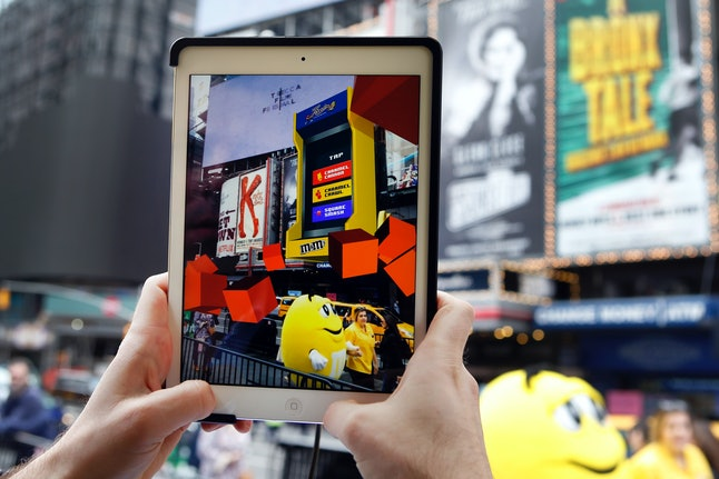M&Ms transformed Times Square's billboards into an augmented reality gaming experience, Thursday, May 11, in New York.