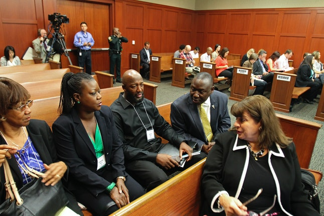 Florida prosecutor Angela Corey, right, speaks to Trayvon Martin's parents in a state courtroom in 2013.
