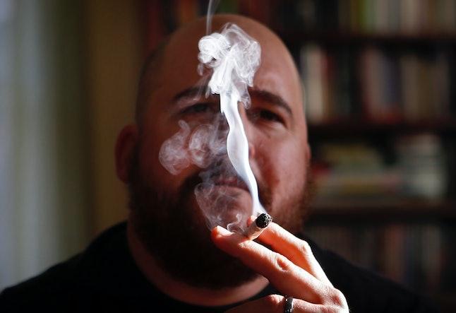 A former U.S. marine smokes medical marijuana in Maine.