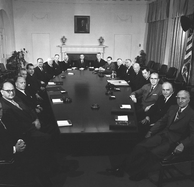 Former President Dwight Eisenhower with his cabinet members in January 1961