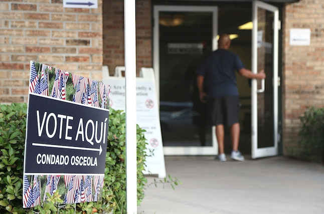 A voter enters an Osceola County polling station during early voting in the federal election Oct. 25, 2016, in Kissimmee, Florida.