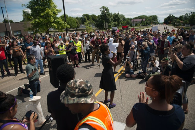 Activists speak to a crowd outside of the St. Anthony Police Department headquarters on July 10.