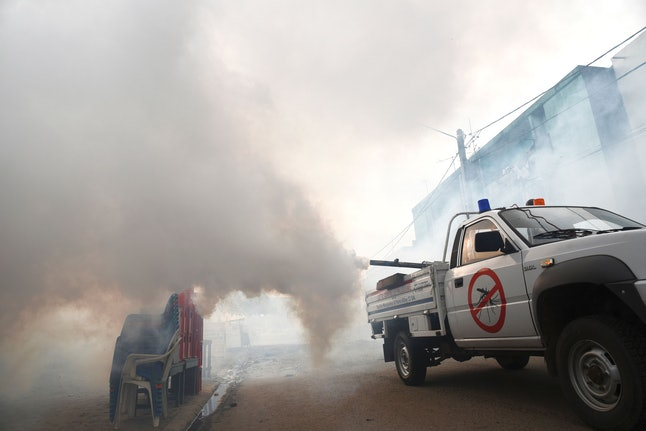 The National Institute of Public Health sprays mosquito repellant in an effort to control the spread of Zika in the Koumassi district of Abidjan.