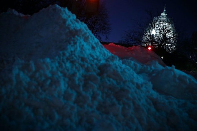 A pile of snow rests near the Capitol building in Washington D.C.
