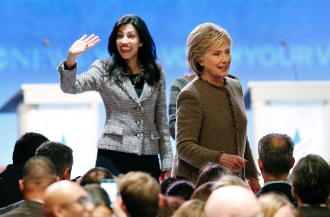 Huma Abedin, left, with Hillary Clinton.