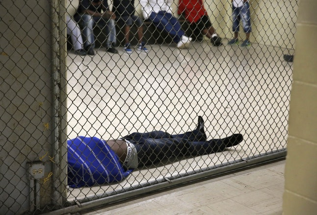 An image of inmates trying to sleep inside the Cook County Jail, where Mays was incarcerated for more than 14 months without ever being convicted of a crime.