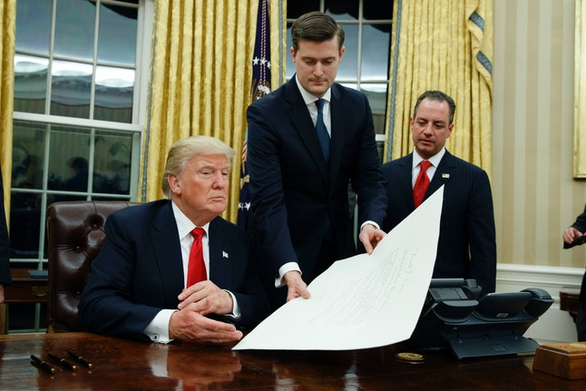 Rob Porter hands President Donald Trump a document on Jan. 20, 2017.