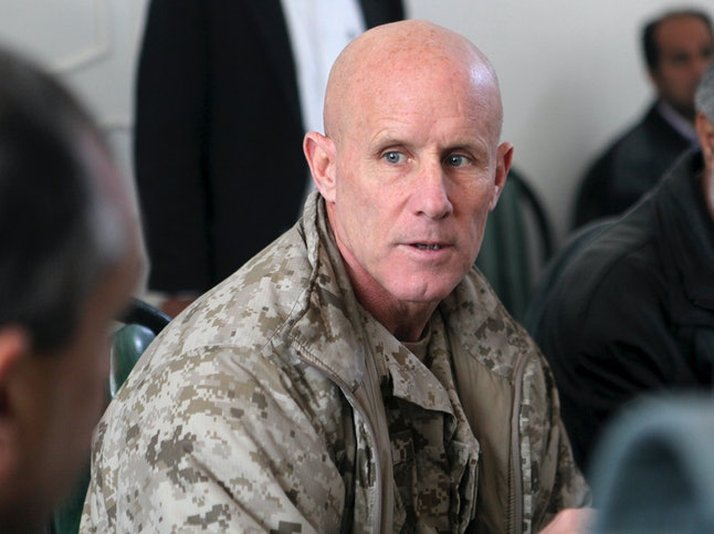 Vice Adm. Robert S. Harward, commanding officer of Combined Joint Interagency Task Force 435, speaks to an Afghan official during his visit to Zaranj, Afghanistan.