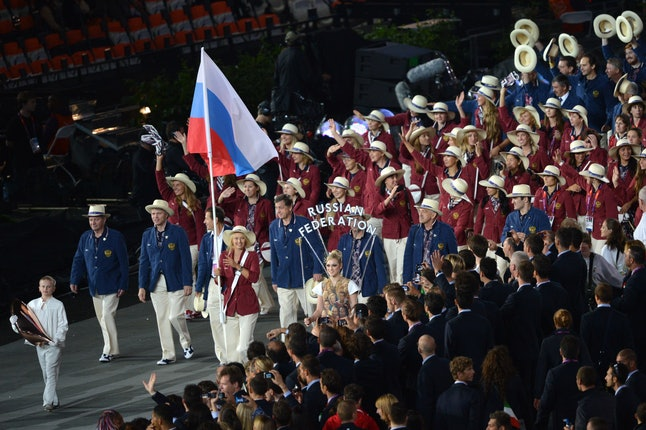 Maria Sharapova bears the Russian flag, leading her country's delegation in the 2012 London Olympics opening ceremony.