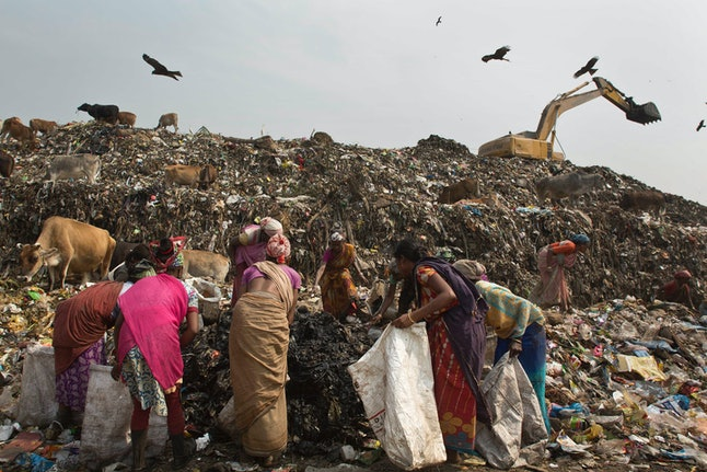 "So-called ""ragpicker"" women search for recyclables on International Women's Day in Gawahati, India."