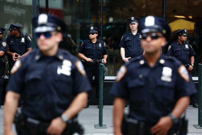 New York Police Department officers are seen at an anti-police brutality protest in July.