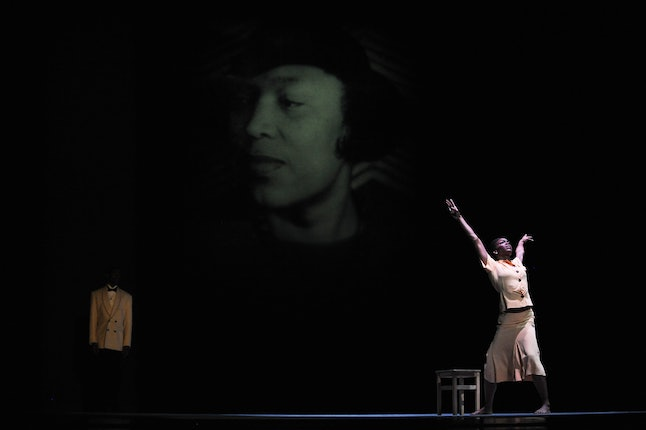 Briana Reed of the Alvin Ailey American Dance Theater rehearses in front of a photograph of writer Zora Neale Hurston, Dec. 9, 2009 in New York.