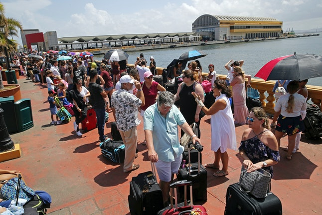 Thousands of people line up to evacuate Puerto Rico via a cruise ship in the aftermath of Hurricane Maria.