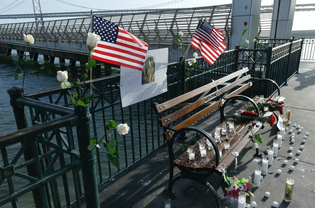Flowers and a portrait of Kate Steinle remain at a memorial site on Pier 14 on Dec. 1 in San Francisco.