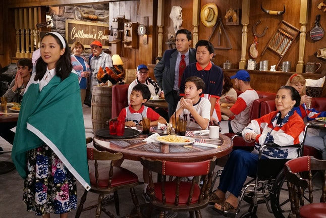 The Huangs watch the Olympics together at Cattleman's Ranch.