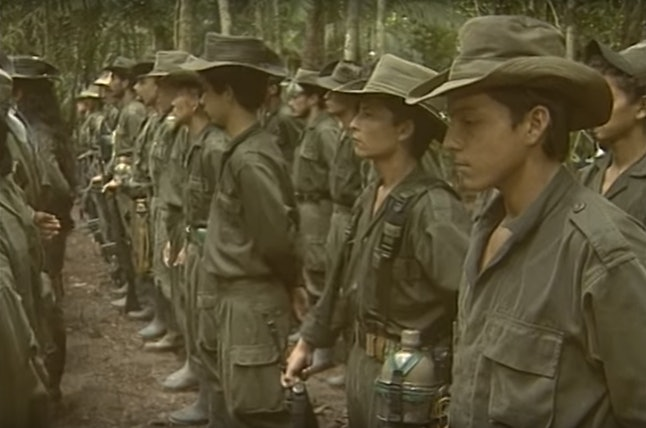 Guerrilla soldiers in the Colombian jungle perform a drill.