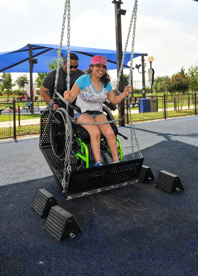 Specialized swings make it possible for people in wheelchairs to experience the simple pleasure of swinging.