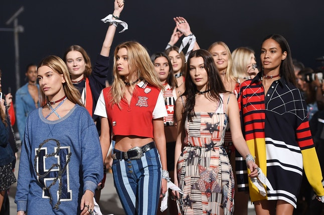 Models Hailey Baldwin (L), Bella Hadid (2R) and other models walk the runway at the TommyLand Tommy Hilfiger Spring 2017 Fashion Show on the boardwalk in Venice, California, February 8, 2017.  / AFP / Robyn Beck