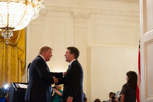 Donald Trump shakes hands with Brett Kavanaugh in the White House in July.