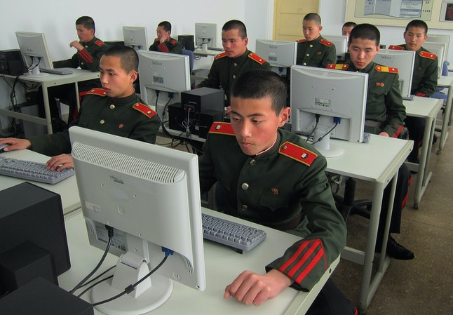Students at the Mangyongdae Revolutionary School in Pyongyang work on computers on April 18, 2013.