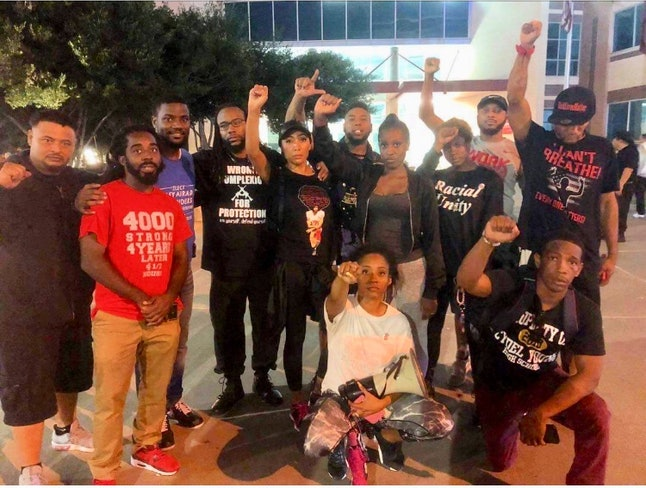 Protesters demonstrate in support of Botham Shem Jean outside the Dallas Cowboys' AT&T Stadium in Arlington, Texas, on Sunday.