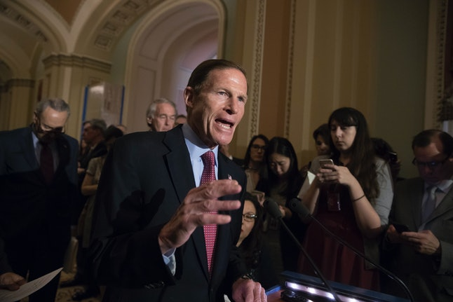 Sen. Richard Blumenthal answers reporters questions about the Trump-Russia investigation in May.