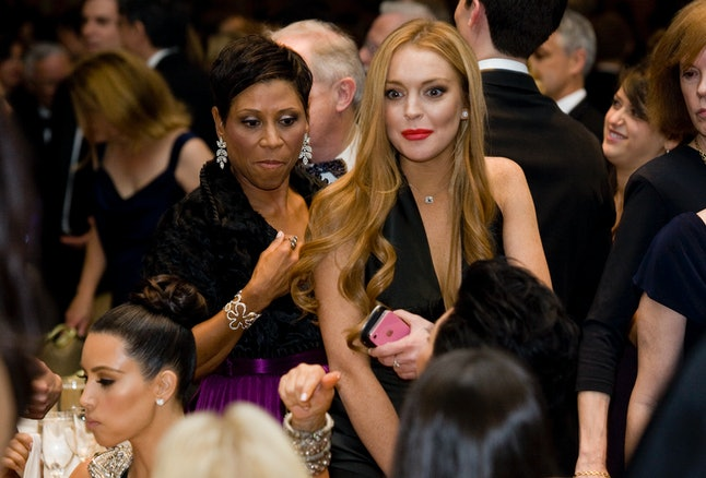 Actress Lindsay Lohan attends the 2012 correspondents' dinner with her lawyer Shawn Chapman Holley.