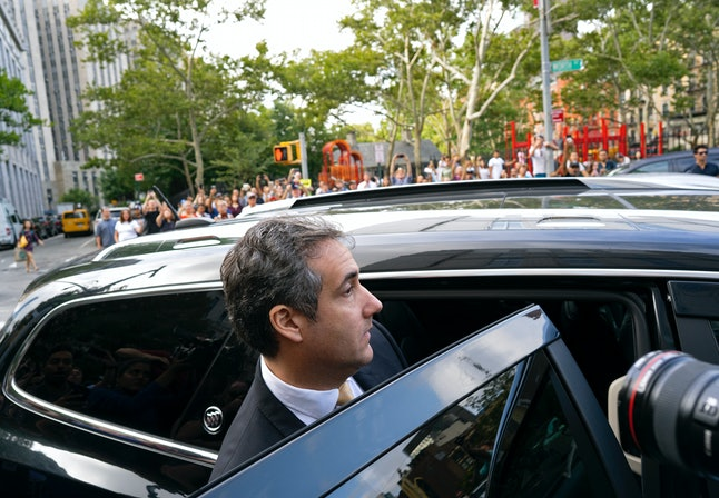 Michael Cohen leaves federal court after agreeing to a plea deal on Tuesday.