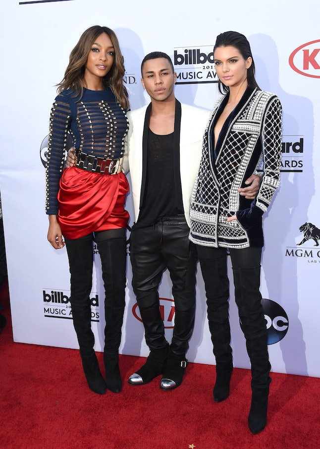 Oliver Rousteing (middle) with models Jourdan Dunn and Kendall Jenner reveal the first pieces of H&M x Balmain at the 2015 Billboard Music Awards