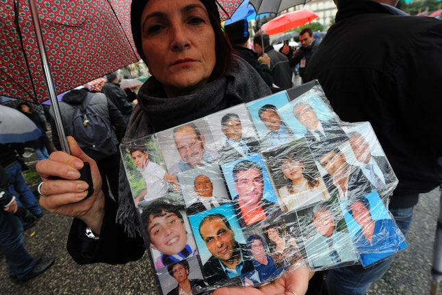 An Italian woman protests the deaths of victims of the illegal dumping.