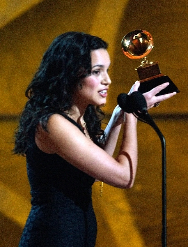 Norah Jones accepting one of the two awards she won during the 45th Annual Grammy Awards in New York City, Sunday, Feb. 23, 2003.