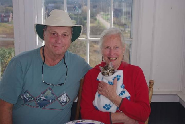 Linda, her husband and a rescue kitten.