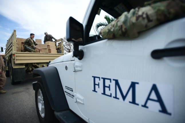 Department of Homeland Security personnel deliver supplies to Santa Ana community residents in Guayama, Puerto Rico, in the aftermath of Hurricane Maria.