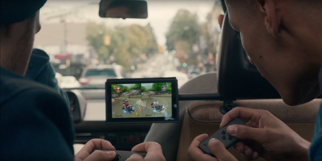 That sure looks like Mario Kart...played from the backseat of a moving vehicle. Do want.