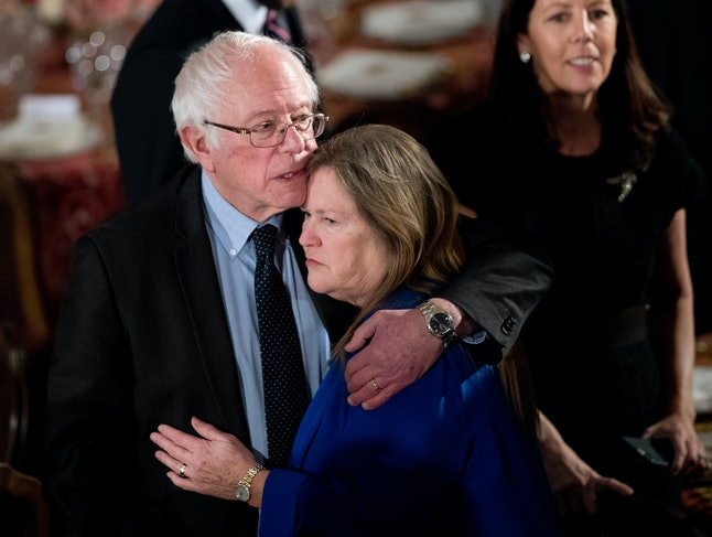 Sen. Bernie Sanders hugs Jane Sanders during the inauguration of President Donald Trump.