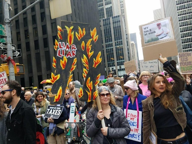 Tax Day March protesters rally to pressure President Donald Trump to release his tax returns on April 15 in Midtown Manhattan.