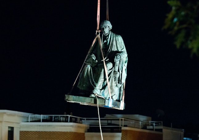 Workers used a crane to remove the monument dedicated to U.S. Supreme Court Chief Justice Roger B. Taney.