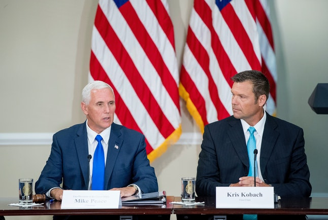 """Vice President Mike Pence and Kansas Secretary of State Kris Kobach are the leaders of the president's """"voter fraud"""" panel."""