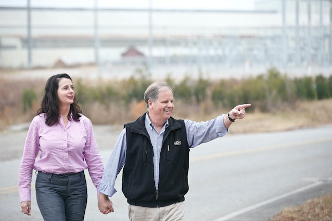 Democratic senatorial candidate Doug Jones appears with his wife, Louise Jones, to speak at a news conference Dec. 4 in Dolomite, Alabama.