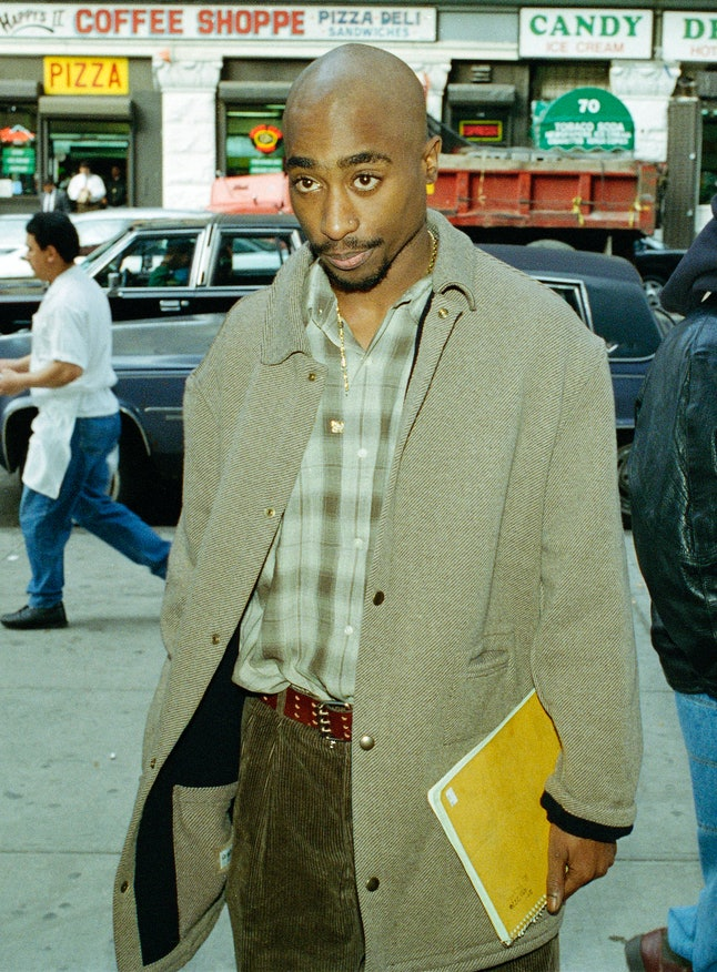 Tupac waiting to go through a metal detector outside a New York court