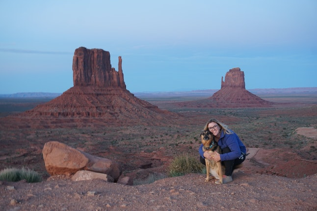 The author and Sophie posing at sunset in Monument Valley, Utah